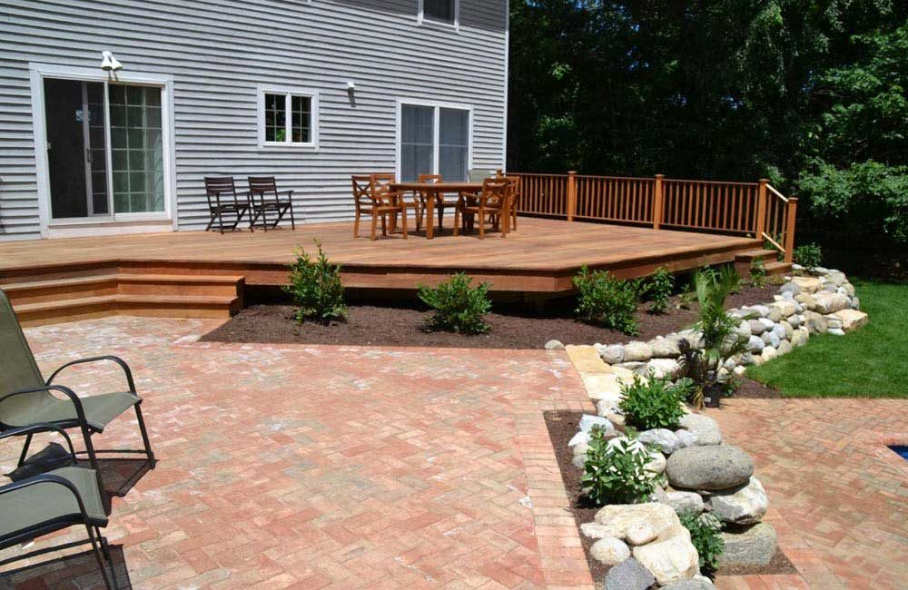 Backyard with custom deck and brick patio