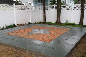 Custom design bluestone border and inlay with brick accent Saratoga Springs