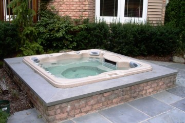 Sunken Hot Tub with bluestone and brick surround