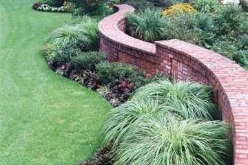 Curved brick with style inlay front wall