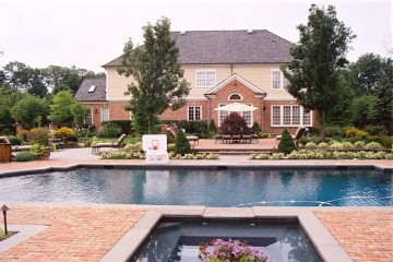 Custom Pool and hot tub brick and bluestone patios