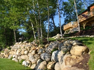 Large boulder retaining wall overlook deck Glen Lake