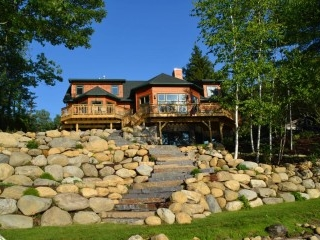 Lake front boulder retaining walls with granite slab steps Glen Lake