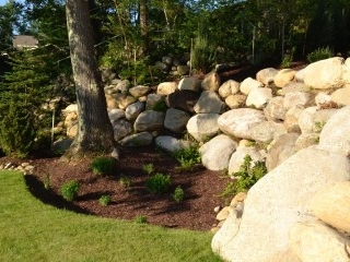 Large boulder retaining wall Glen Lake