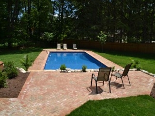Herringbone pattern Brick Patio with pool view