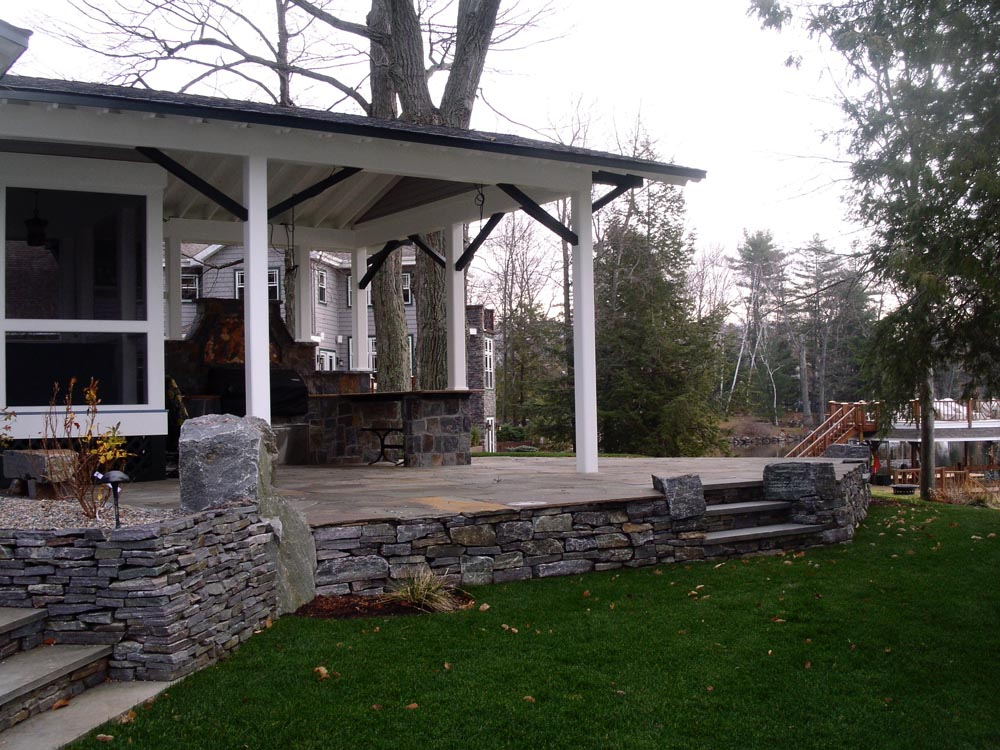 Assembly Point covered masonry BBQ, bluestone patio and granite retaining walls
