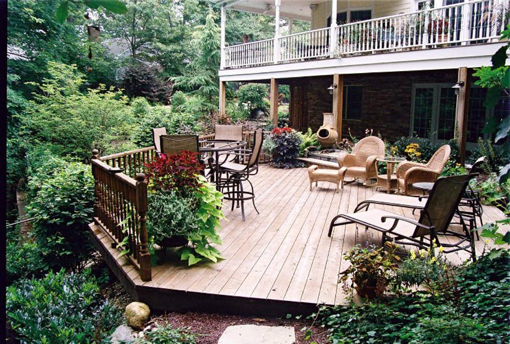 Rustic Deck with wrap around porch overhead