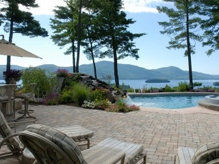 Lake views Pool patio with custom stone waterfall in Bolton landing
