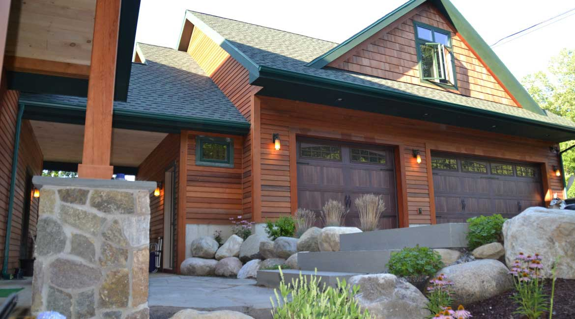 Custom garage with landscaping