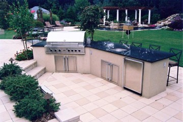 Outdoor Kitchen with views to the pool and waterfall