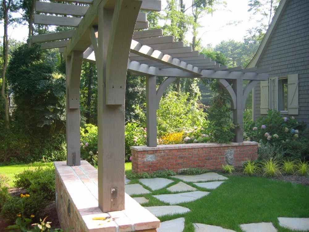 Timber frame and brick structure, simple stepping stone patio, cottage feel